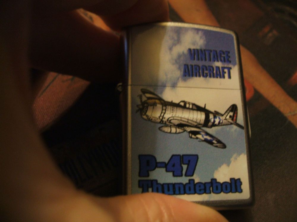 A Nice And Colorful Vintage Aircraft Series P 47 Thunderbolt World War2 Fighter Zippo Lighter Done In The Nice Satin Chrome Finish And Comes With Orange Sticke