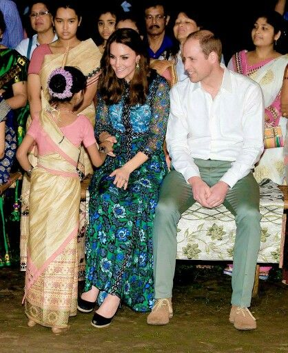 The Duke and Duchess of Cambridge watch dancing by the fireside during a Bihu Festival Celebrationat Diphlu River Lodge on day 3 of the royal visit to India and Bhutan on April 12, 2016 in Kaziranga, India.
