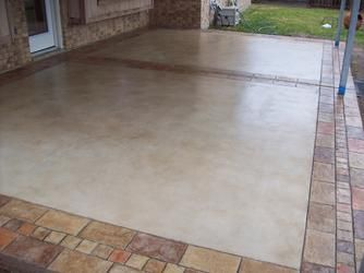 Concrete Patios · Dyed Concrete With Stamped Brick Edge.