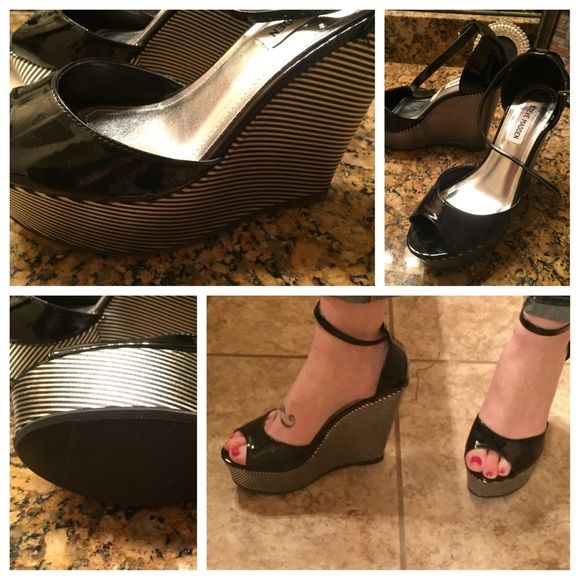Steve Madden silver and black wedge Great wedge dress shoe. Black and silver. Size 7. Bundle and get 10% off your bundle!!! Steve Madden Shoes Wedges