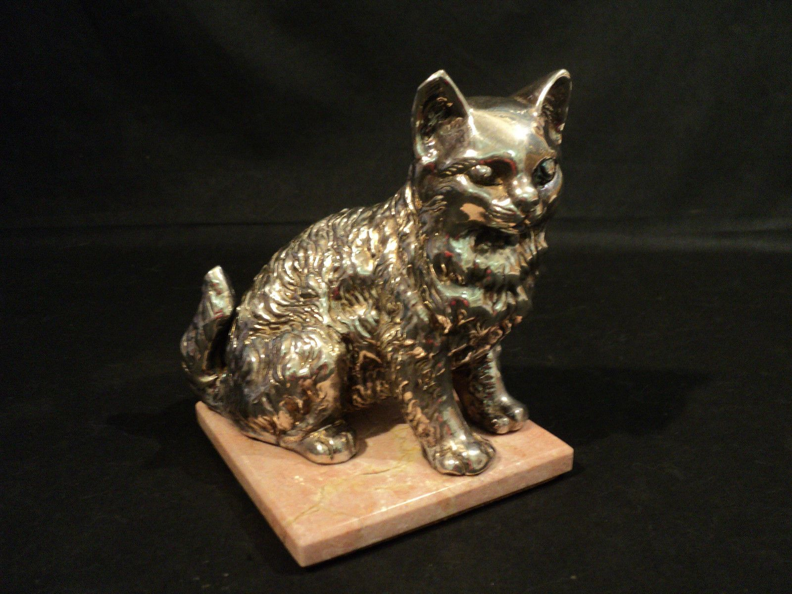 """vintage Sterling Silver """"Cat/Kitten"""" figurine mounted on a pink marbelized tile. The base is stamped with unidentified hallmarks on back left paw. The figure appears to be weighted rather than solid silver  Measures 5"""" high with the tile being 3 3/4"""" square"""