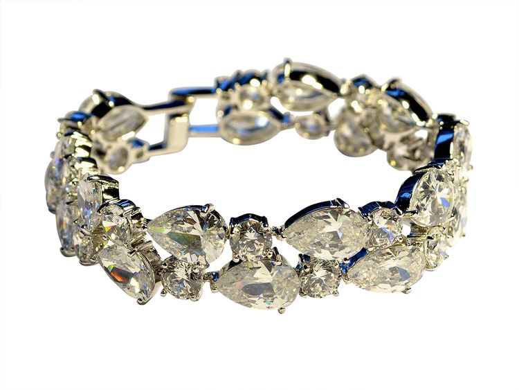 Ashley's combination of pear cut and round cubic stones provide a striking shine. This is definitely a statement piece.  18K white gold plated / Swiss cubic zerconia.  18cm length $72