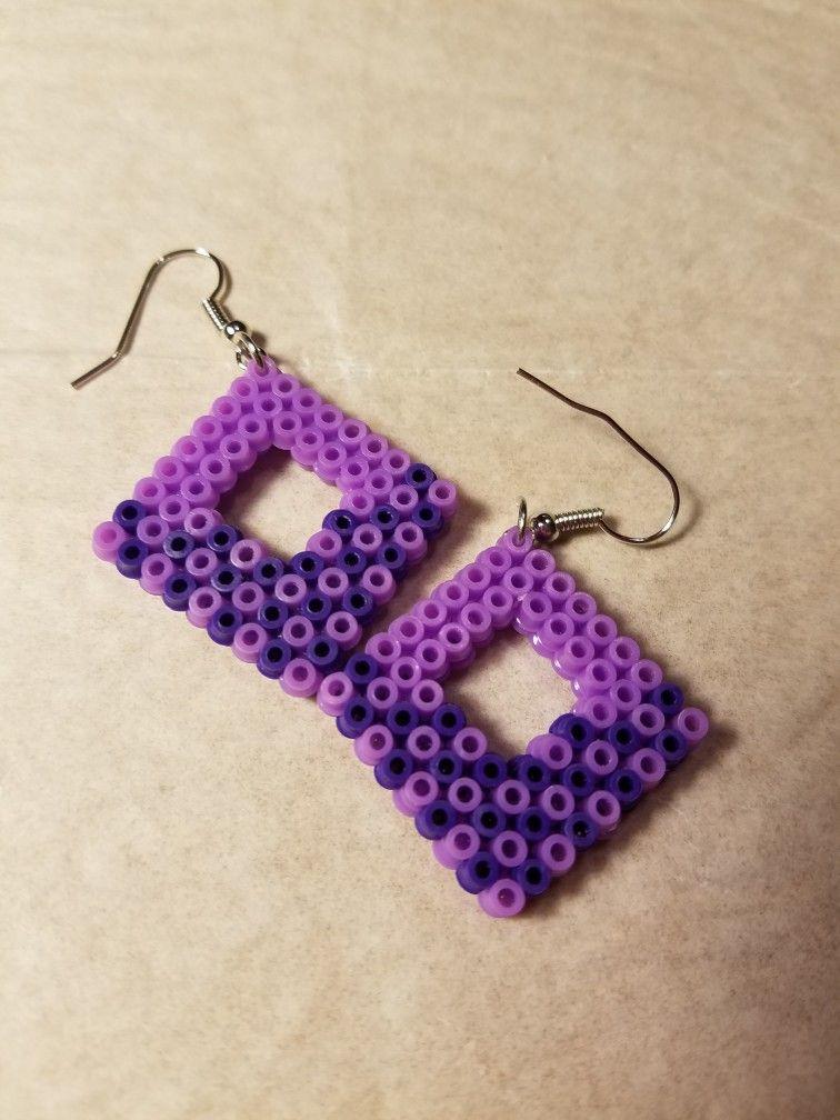 Purple earrings made with mini perler beads