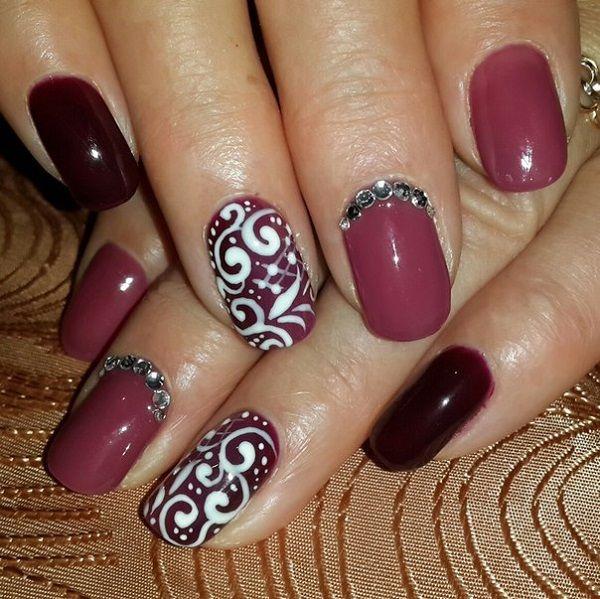 Tribal Inspired White And Maroon Nail Art Design The Nails Have A Maroon Polish Maroon Nails Maroon Nail Designs Nail Art Designs