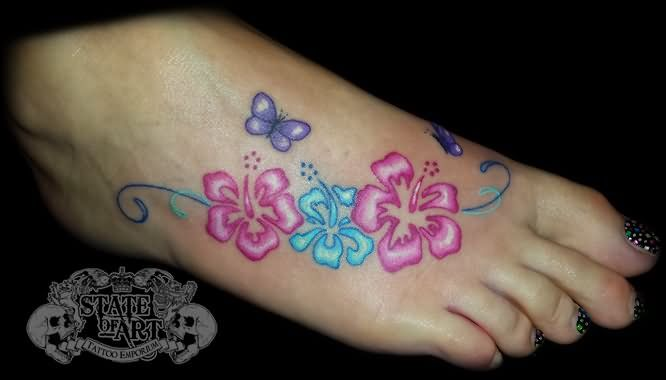Colored Hibiscus Tattoos On Foot By State Of Art Tattoo Hibiscus Tattoo Tattoos For Women Flowers Foot Tattoos