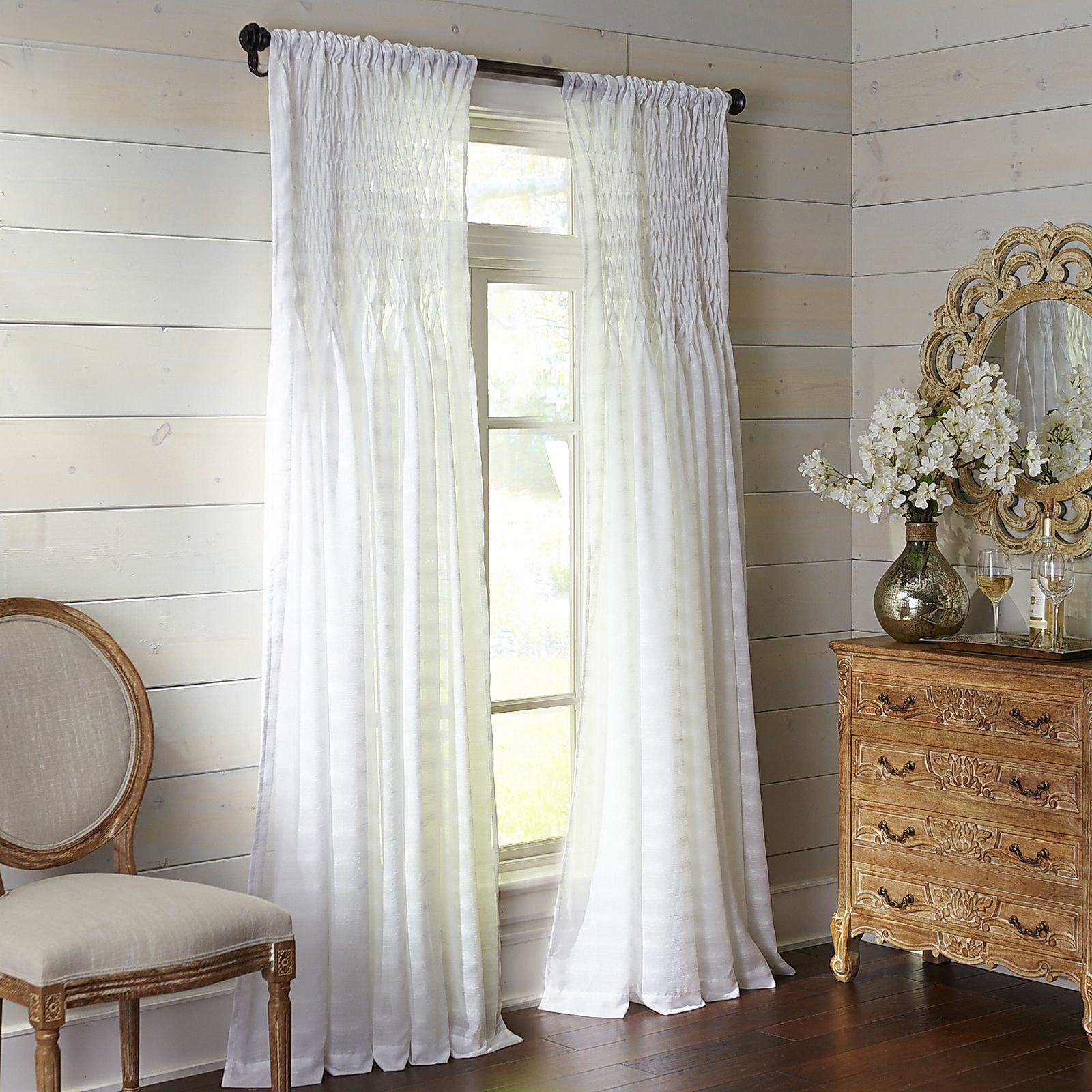 Popular window coverings  our breezy sheer panel is embellished at the top with tiny