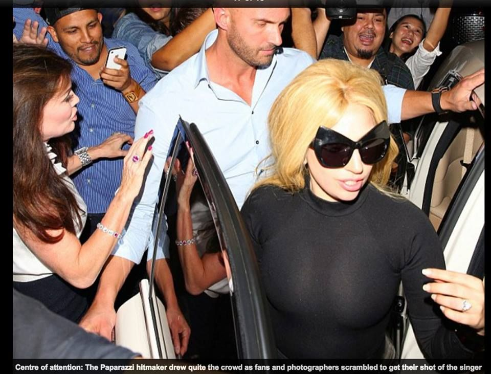 Gaga wore Mercura cat ears in the Telephone video prisoner scene!  Lady Gaga flaunts her ample cleavage and pert derriere in tight black top and PVC fishtail skirt as she dines out in Hollywood By NOLA OJOMU FOR MAILONLINE PUBLISHED: 04:07 EST, April  | UPDATED: 12:16 EST, April