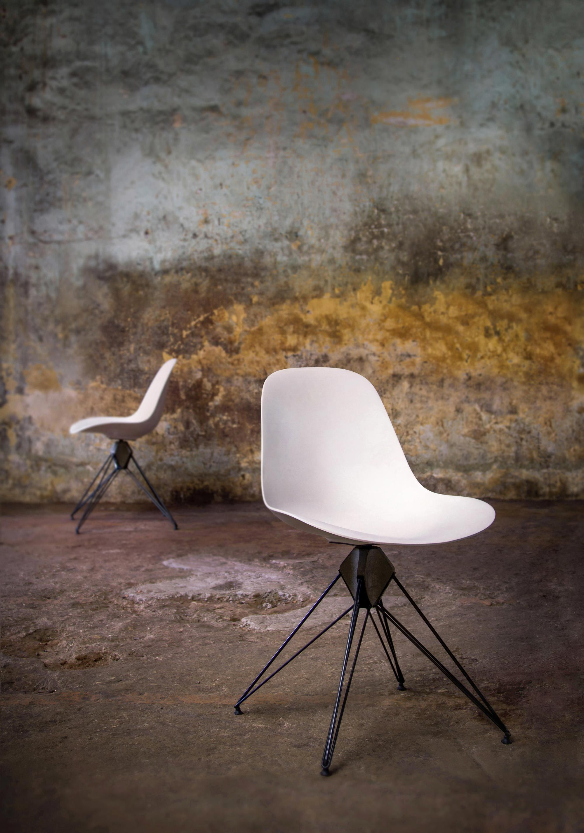 A Solid Surface Shell Chair With A Steel Wire Legs Emanating From A Hand  Crafted Central Concrete Core.