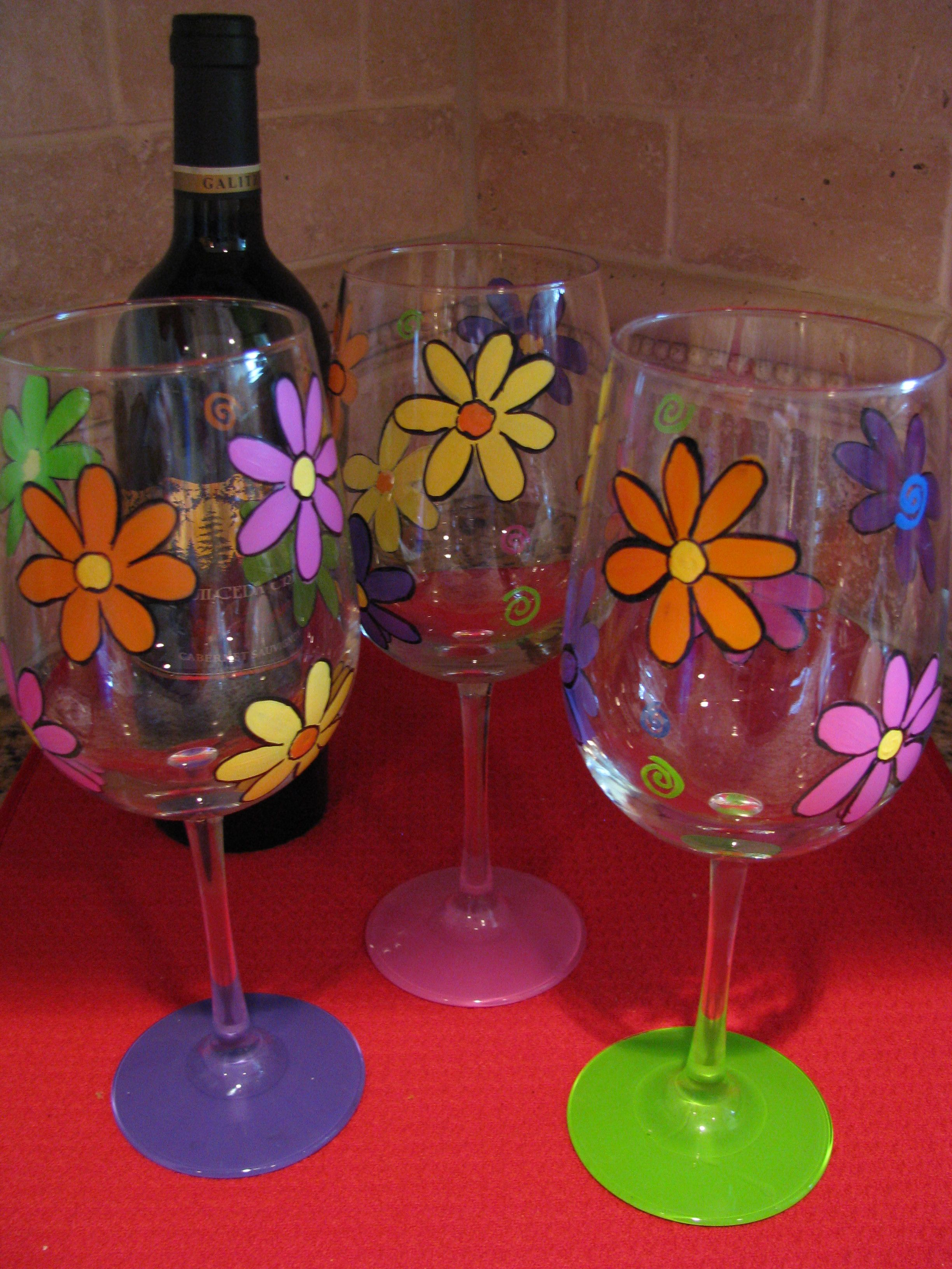 simple flower design on wine glasses each base a