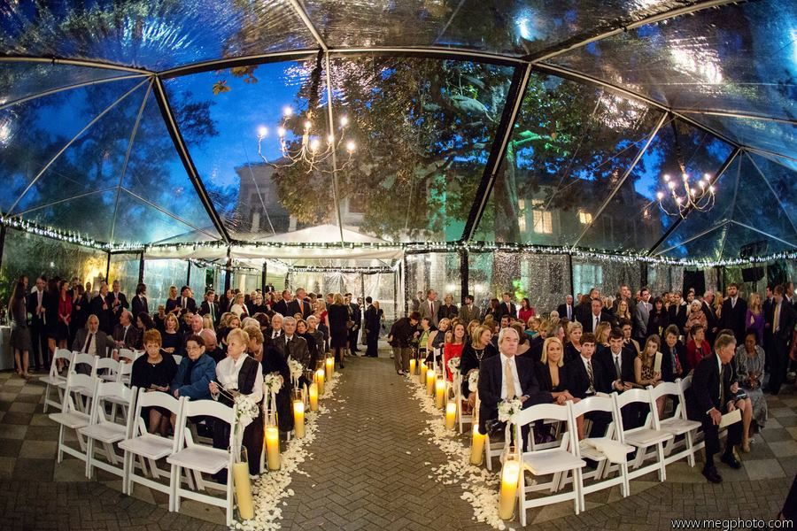 Outdoor Wedding Ceremony Featuring A Clear Top Tent At The