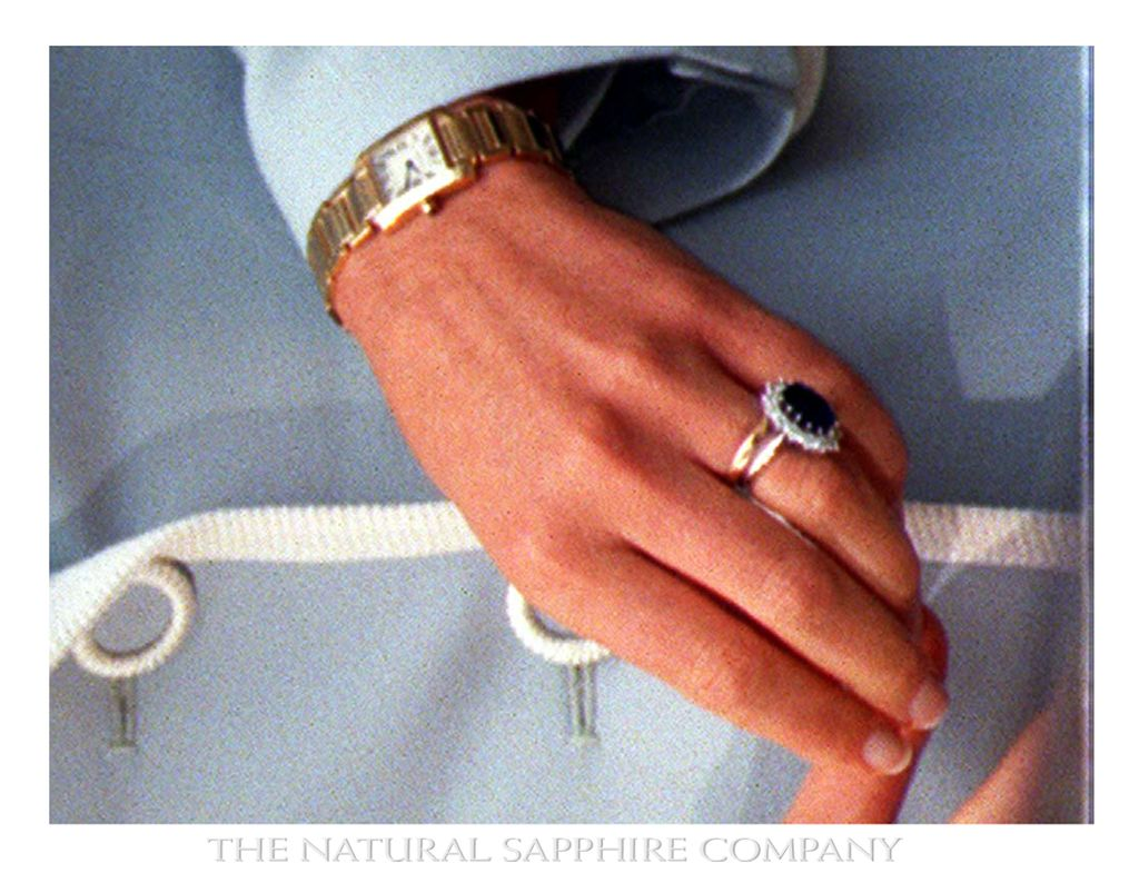 Beneath Princess Diana's sapphire engagement ring is her