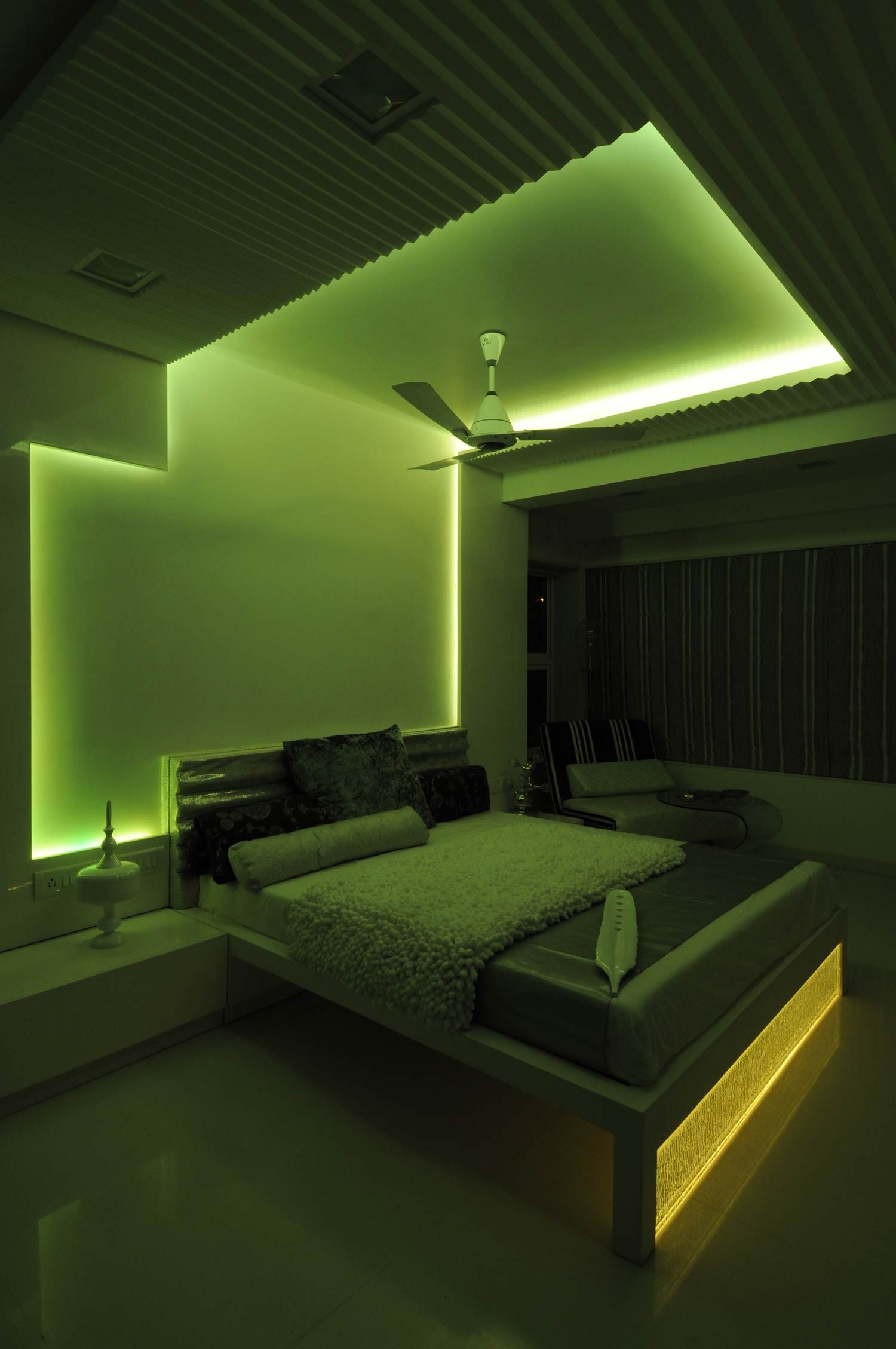 Master bedroom with green neon light design by architect for Design bedroom lighting