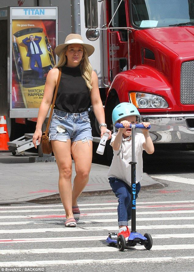 Crossing guard! Hilary Duff kept a close eye on son Luca as he scooted across the road in New York City on Wednesday