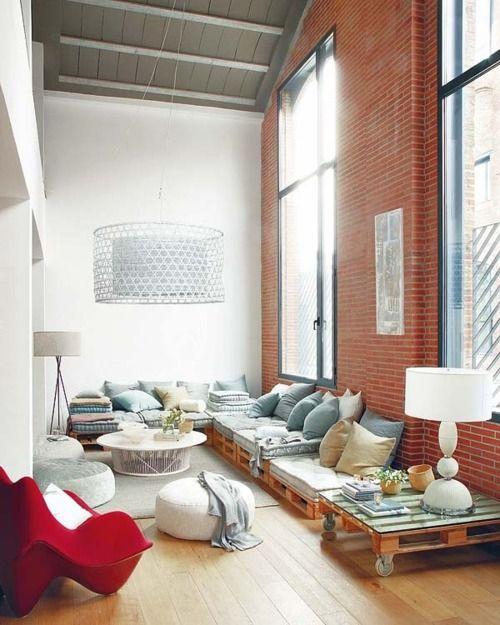 Love the brick wall and huge windows.