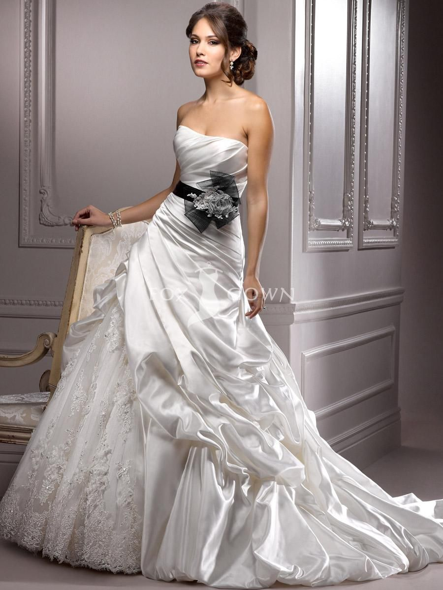 Satin and lace wedding dress with pleated bodice and caughtup skirt