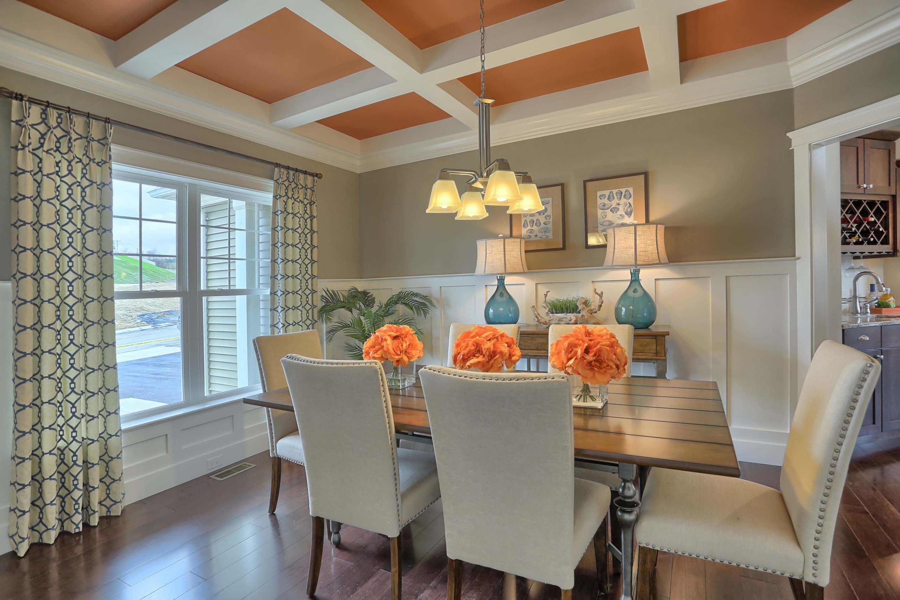 formal dining room with coffered ceiling and craftsman style chair