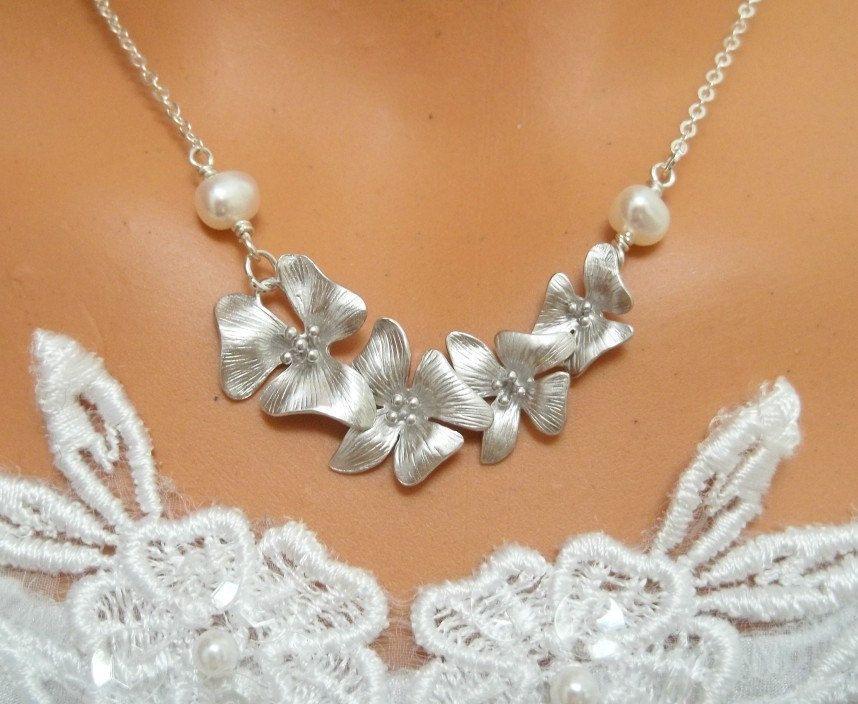 Plumeria Necklace -  Pearl Necklace, Wedding Bride, Bridesmaids Gift, Bridal Jewelry. $31.55, via Etsy.