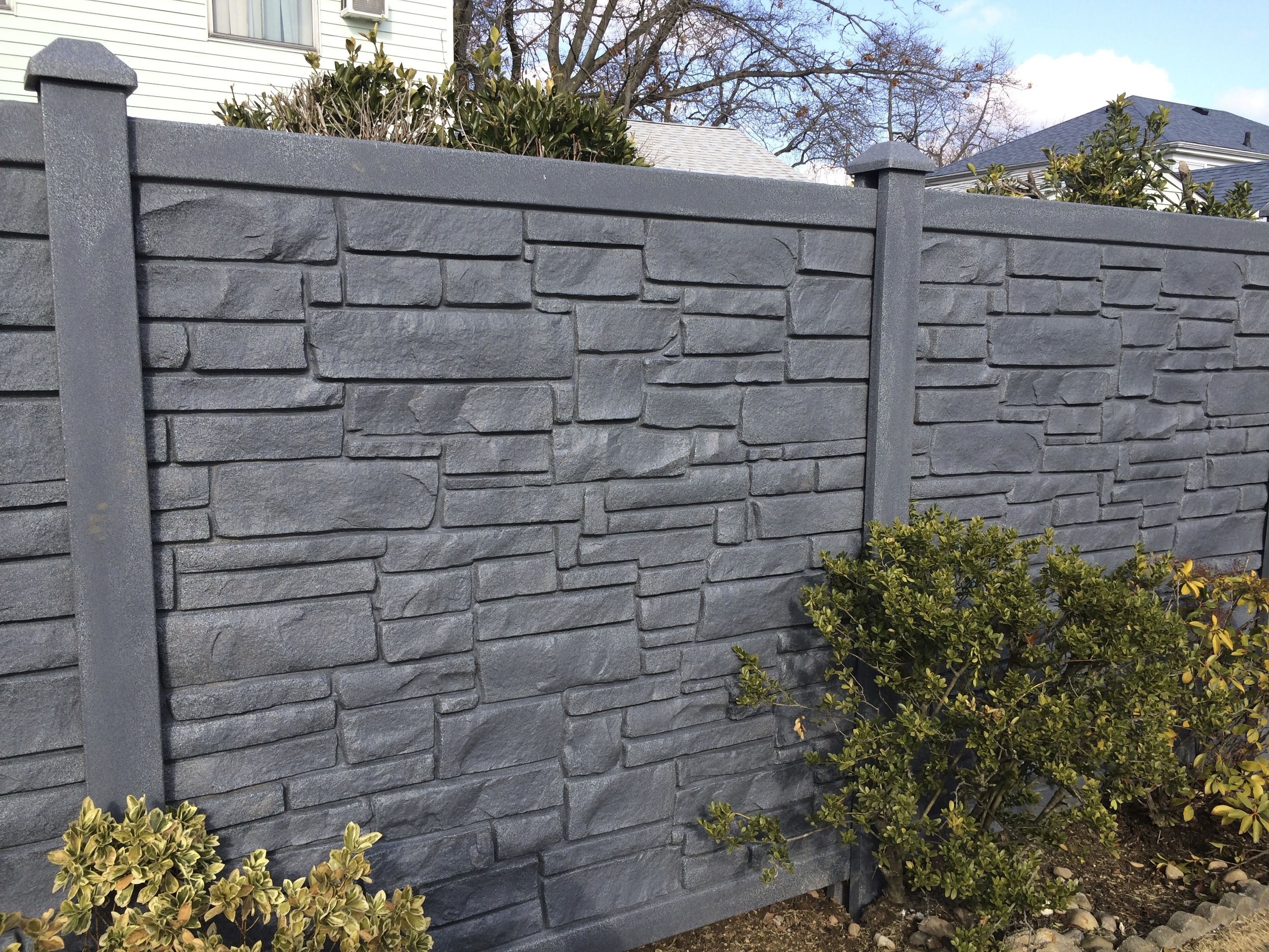 Grey 6ft vinyl stone fence installed by LibertyFence