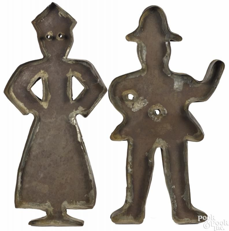Pair of tinned sheet iron cookie cutters, 19th c, of a man and