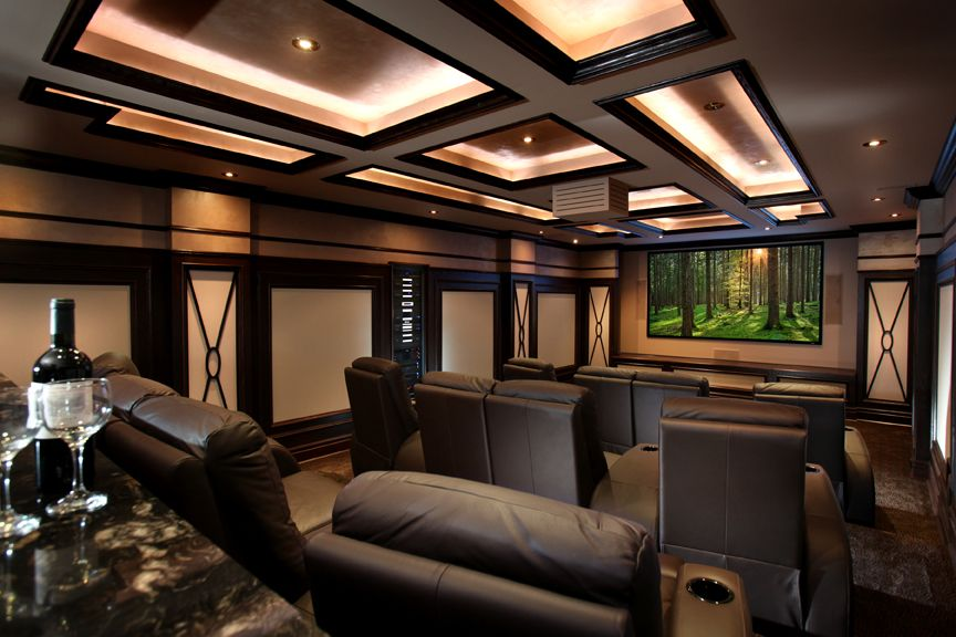 Warm and inviting home theater with bar area at the back | Rich ...