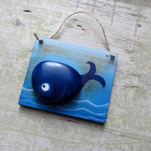 whale, made out of a rock on a piece of wood. Cutie!