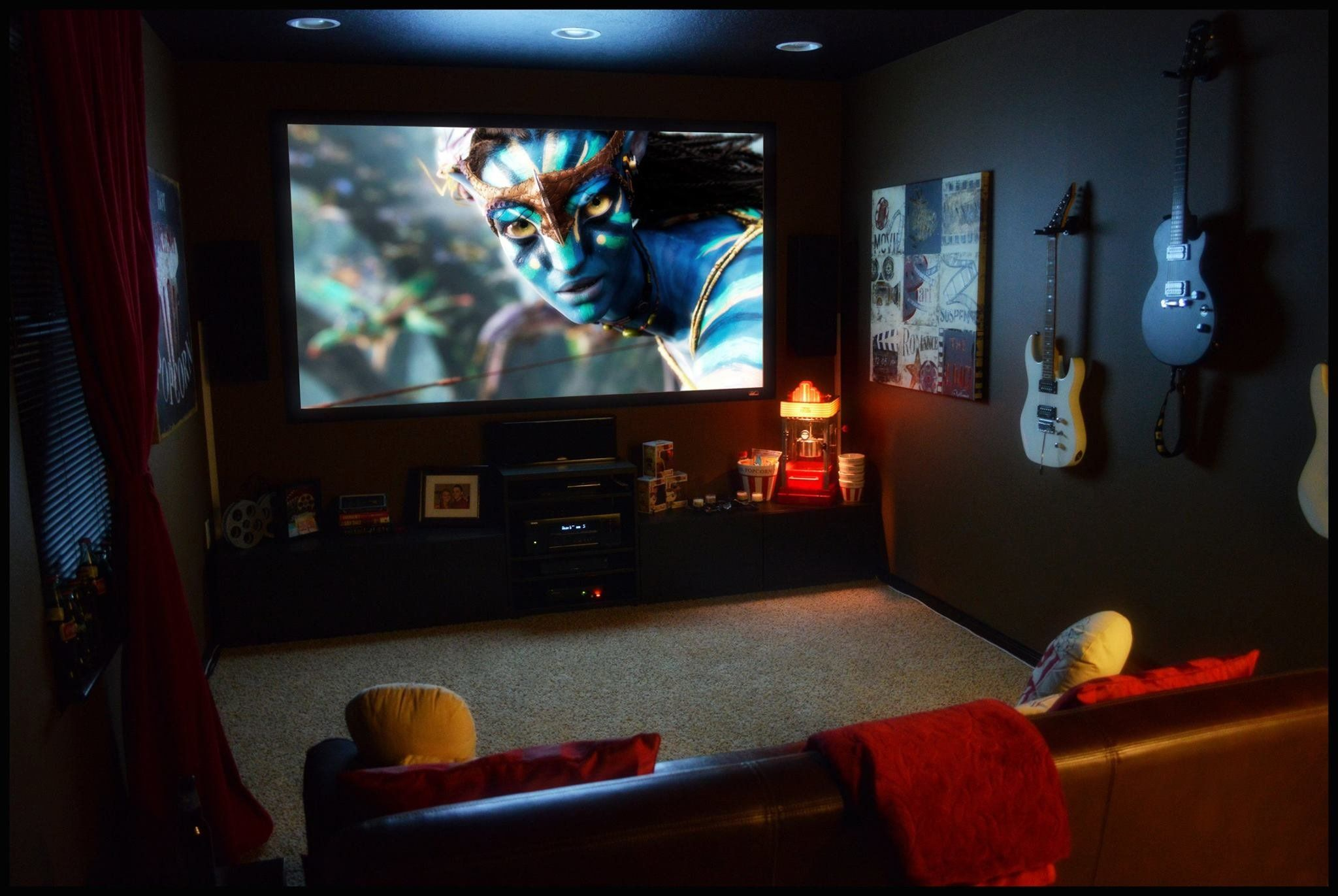 Idea to hang guitars in media room media rooms for Small entertainment room decorating ideas