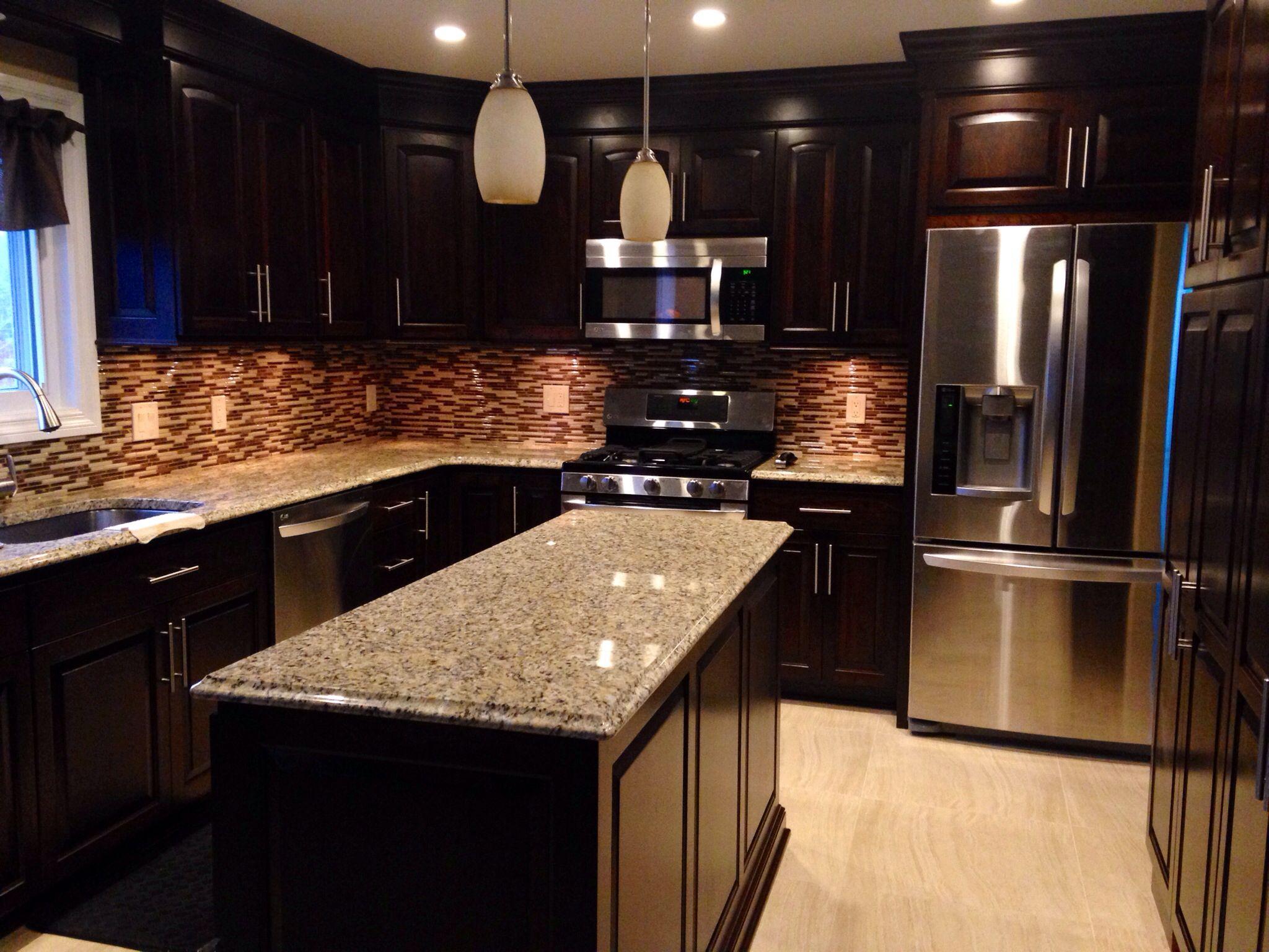 Dark cherry cabinets, granite countertops with light tile ...