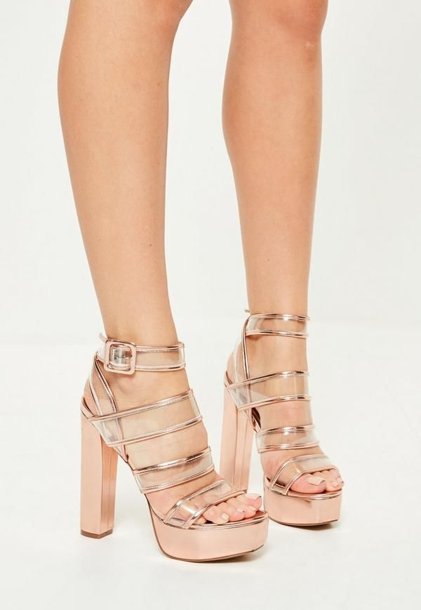 204c3b25e3f Stand out from the crowd in these rose gold heeled platforms with clear  straps and side buckle closure.