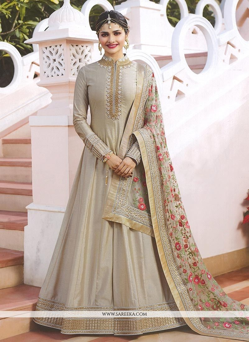 2178fda40c Add the sense of feminine beauty by this Prachi Desai grey art silk salwar  kameez.