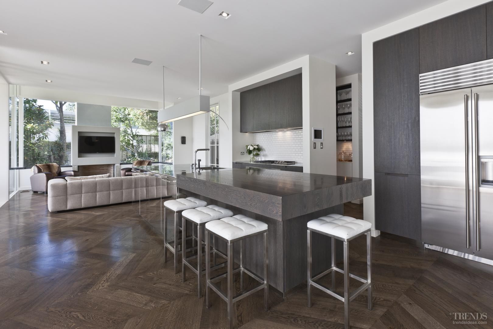 Minimalist contemporary kitchen with stainless steel island by