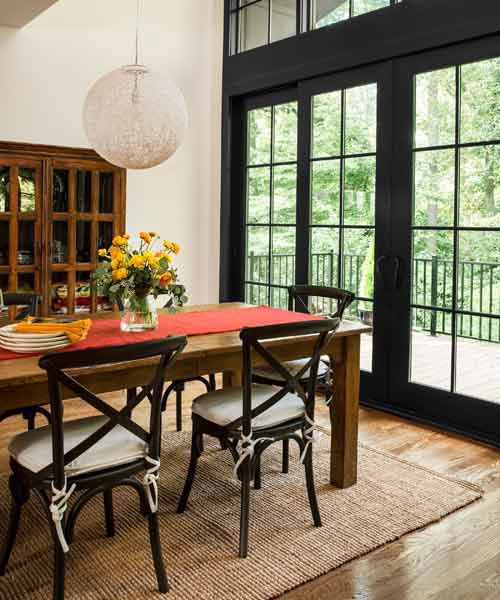 9 Surprising Ways To Decorate With Black Black Patio Furniture Farmhouse Patio Doors 1940s Home