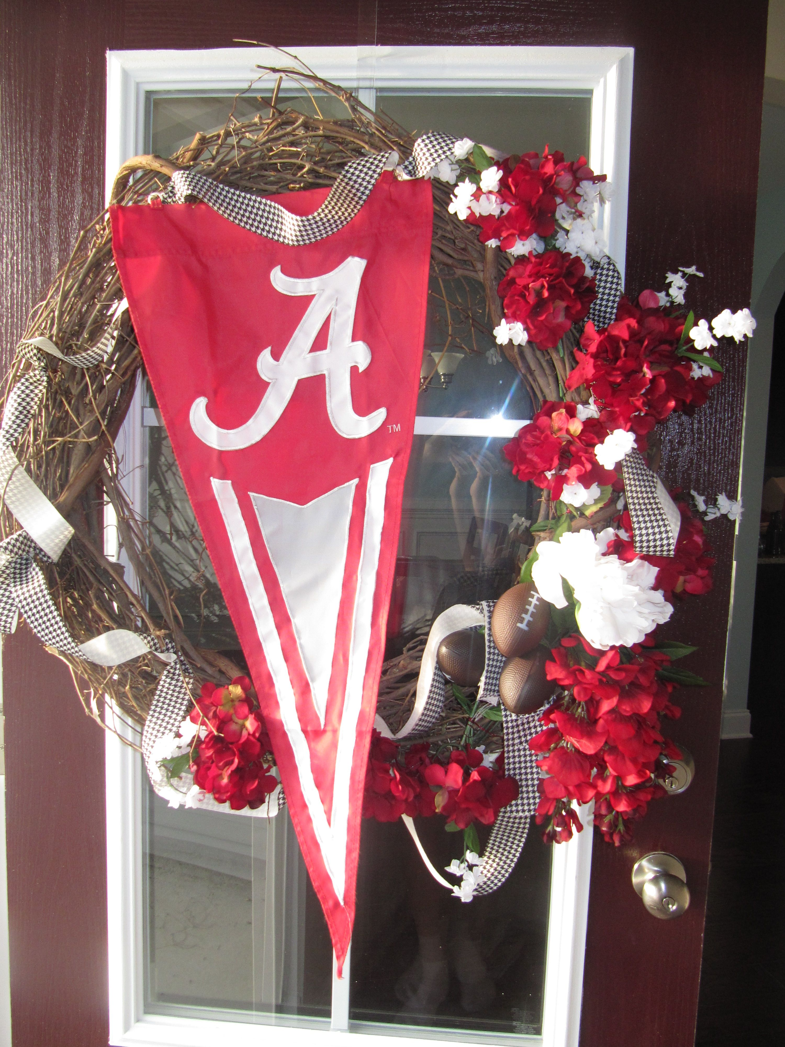 Roll Tide Roll!! My opening season wreath.  It was a wonderful way to welcome my guests to our college football party!  And I made it all by myself!