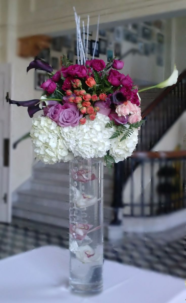 Beautiful suspended orchids with a top of mixed hydrangea