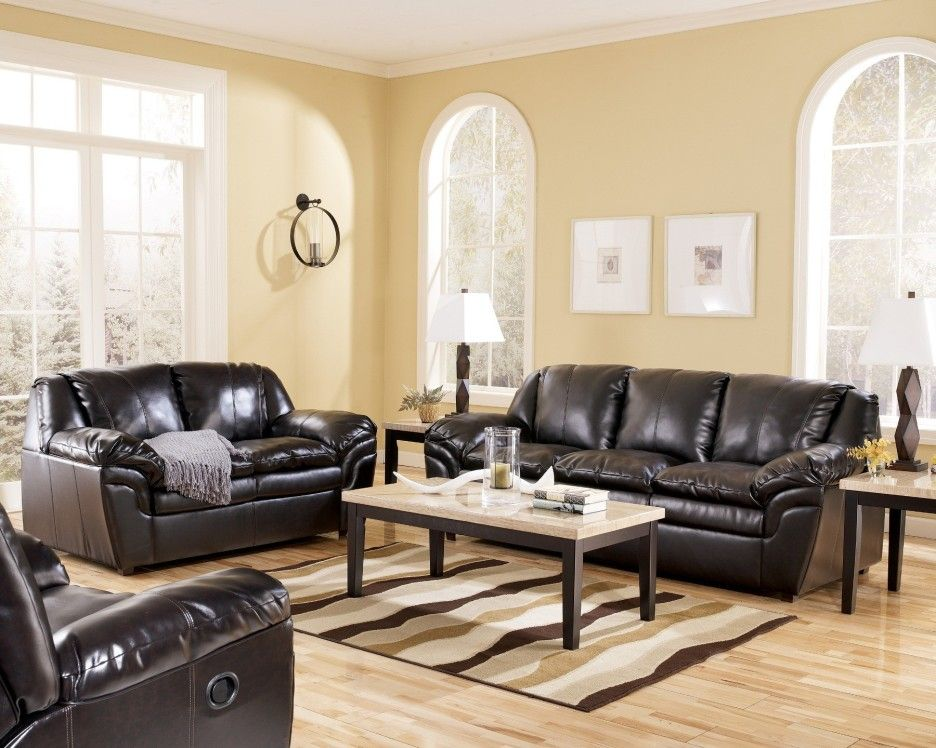 Small Living Room Furnished With Black Leather Sofa And