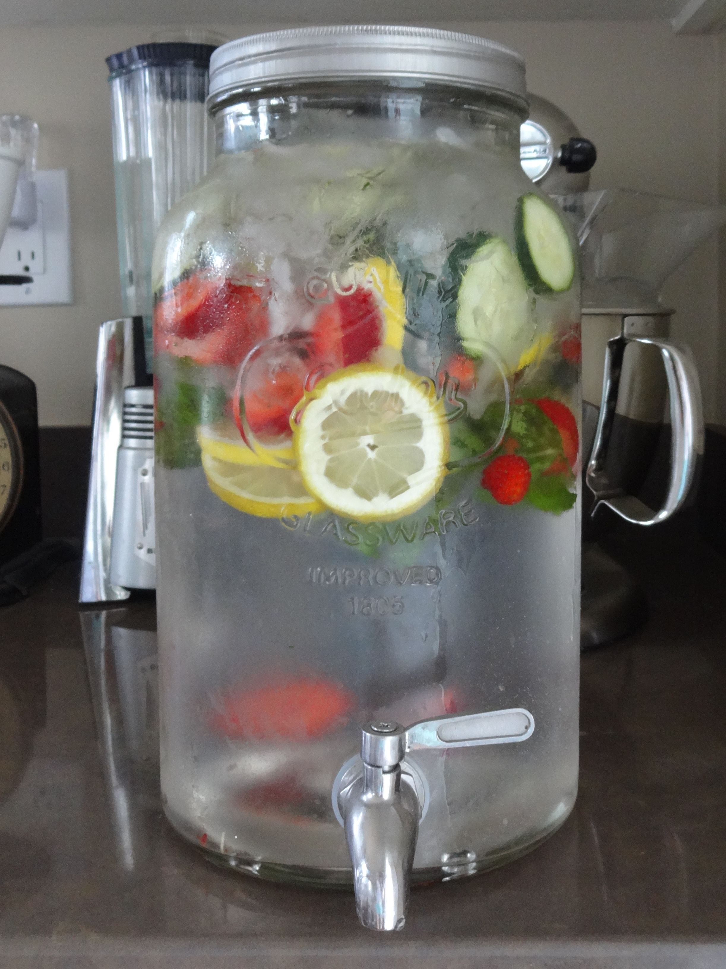 Homemade Fruit Water In A Mason Jar Jug With Spigot