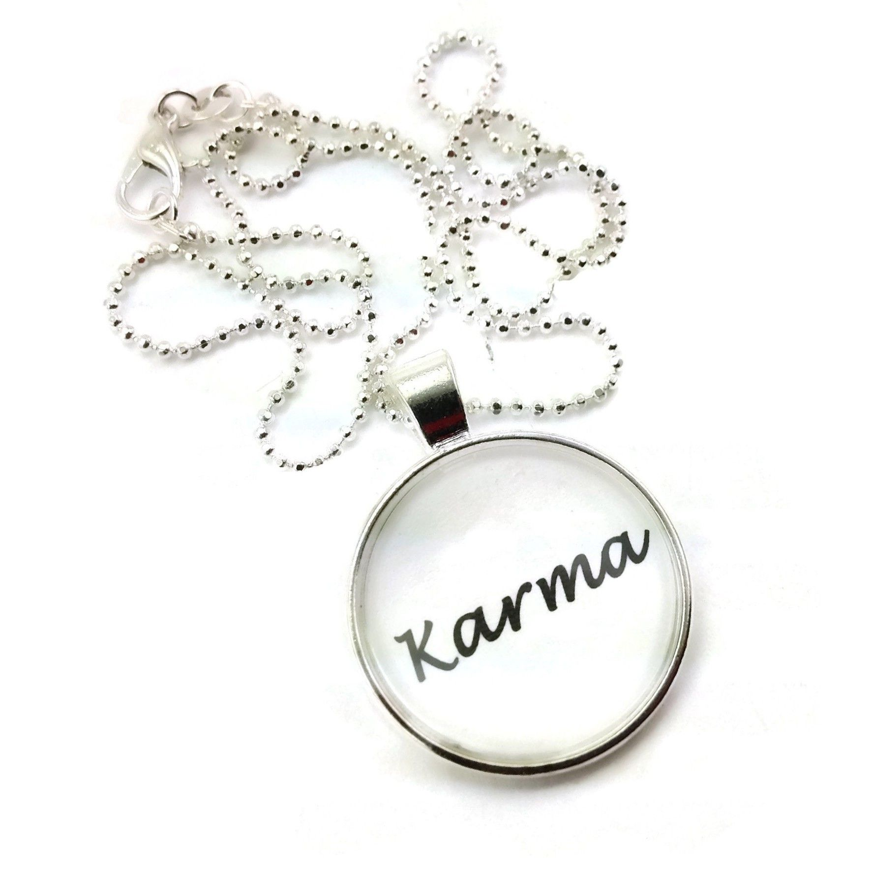 7c47483e4 A great simple design, that just states a simple word, 'Karma', simple but  to the point charm style necklace.