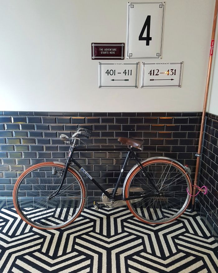 A cool monochrome patterned carpet and bicycles to rent at