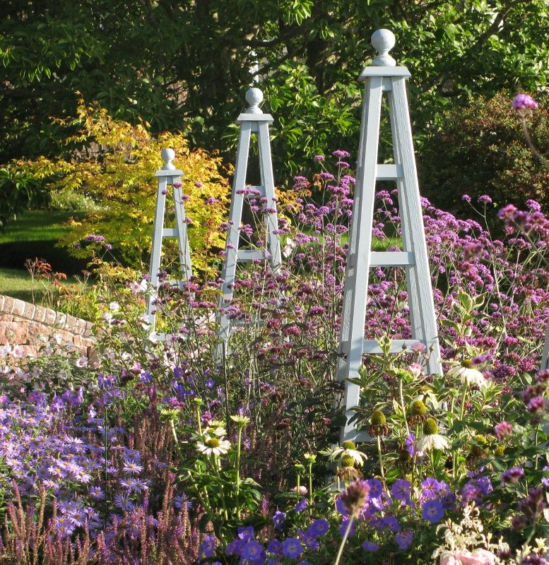 obelisks and planting in a jersey garden design by goose green design - Garden Design Jersey