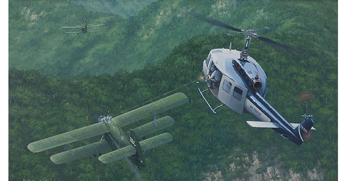 An Air America Bell Helicopter Shooting Down An Attacking North Vietnamese Air Force Colt In Laos