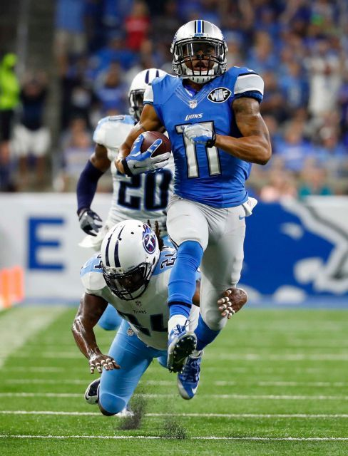 95400a36171 Detroit Lions wide receiver Marvin Jones (11) tries breaking away from  Tennessee Titans free safety Daimion Stafford (24) during the first half of  an NFL ...