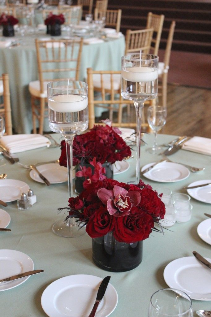 Burgundy wedding for the centerpieces we created duos of