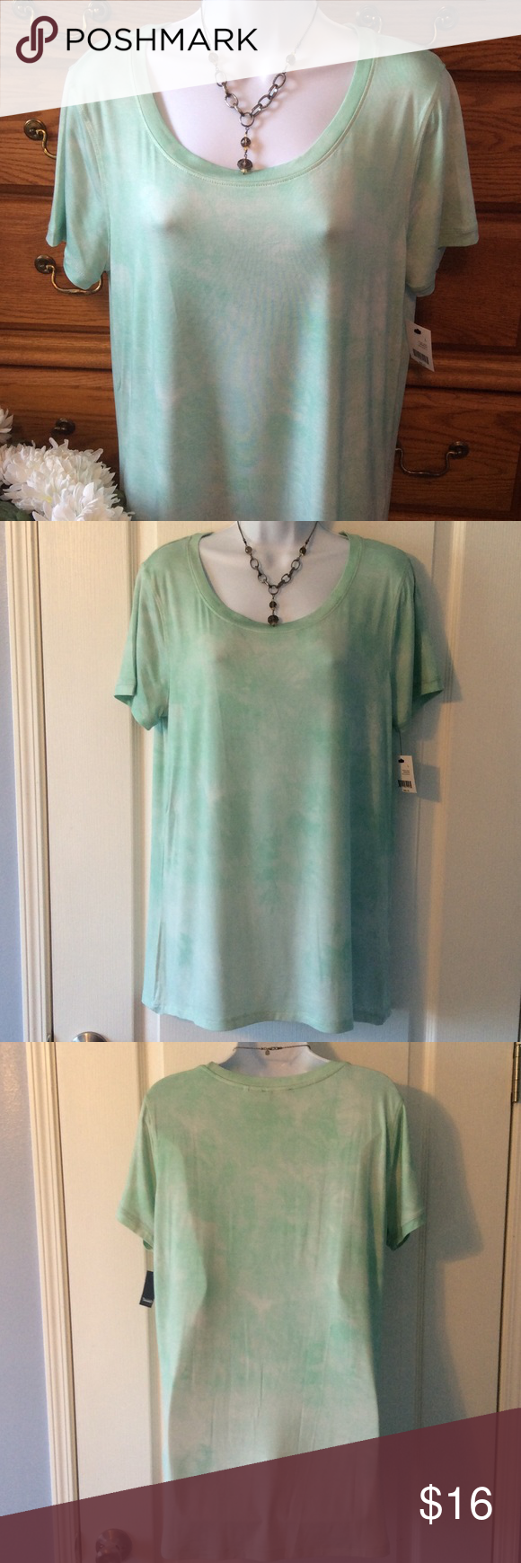 """Tahari Mint Green/White Short Sleeve Top NWT 95% viscose rayon and 5% spandex.  Brand new.  Feels like butter! So soft and comfy.  Approximately 29"""" in length and when measured from armpit to armpit it is 19"""" across.  Has nice stretch.  Color I can best describe as a mint green with touches of white going through it.  The top is called Trish Knit Dragonfly. Tahari Tops Tees - Short Sleeve"""