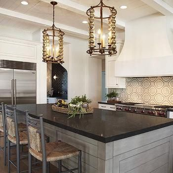 Gray Wash Kitchen Island With Black Granite Countertops
