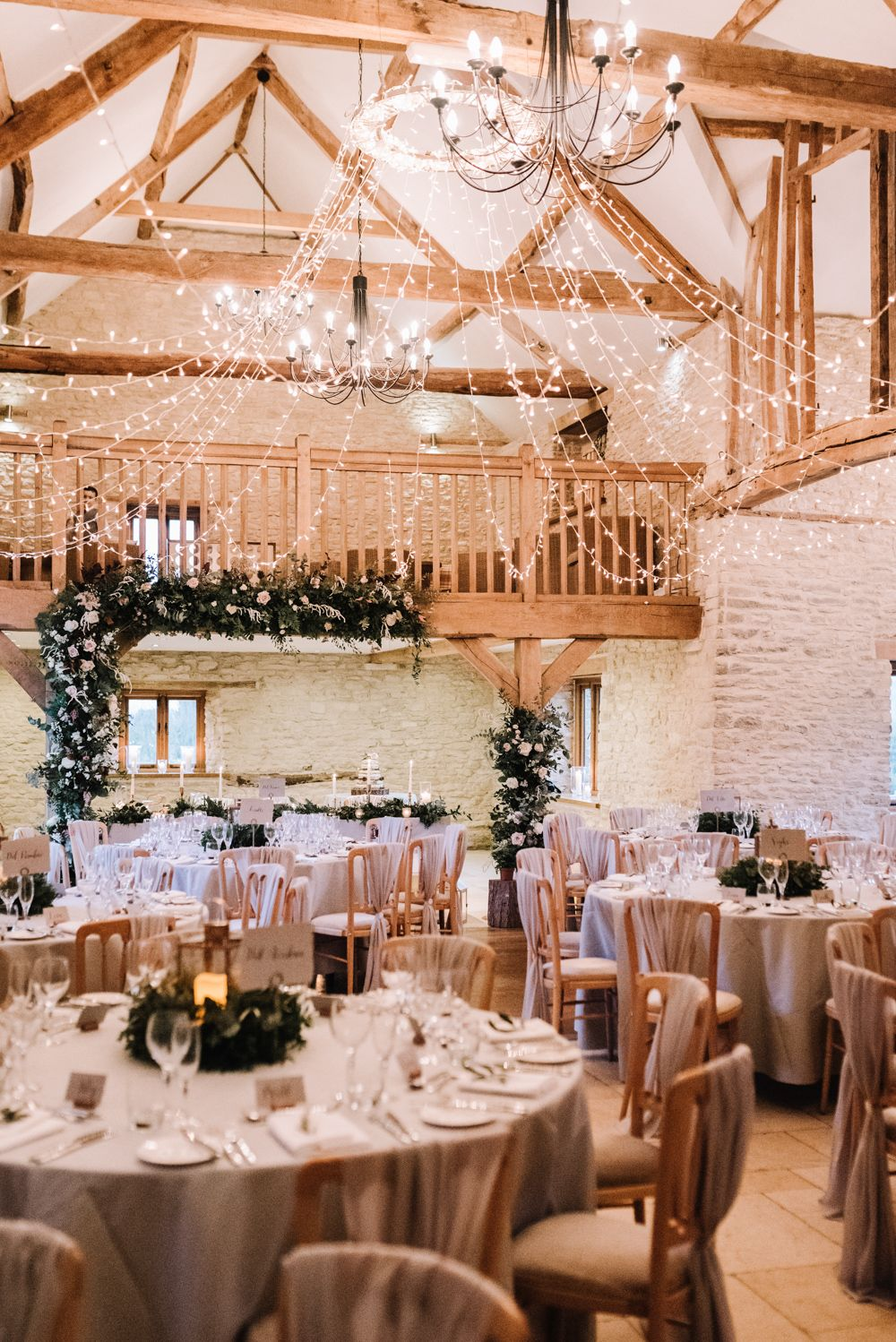 Kingscote Barn Wedding Twinkling Fairy Lights In Winter With Grey