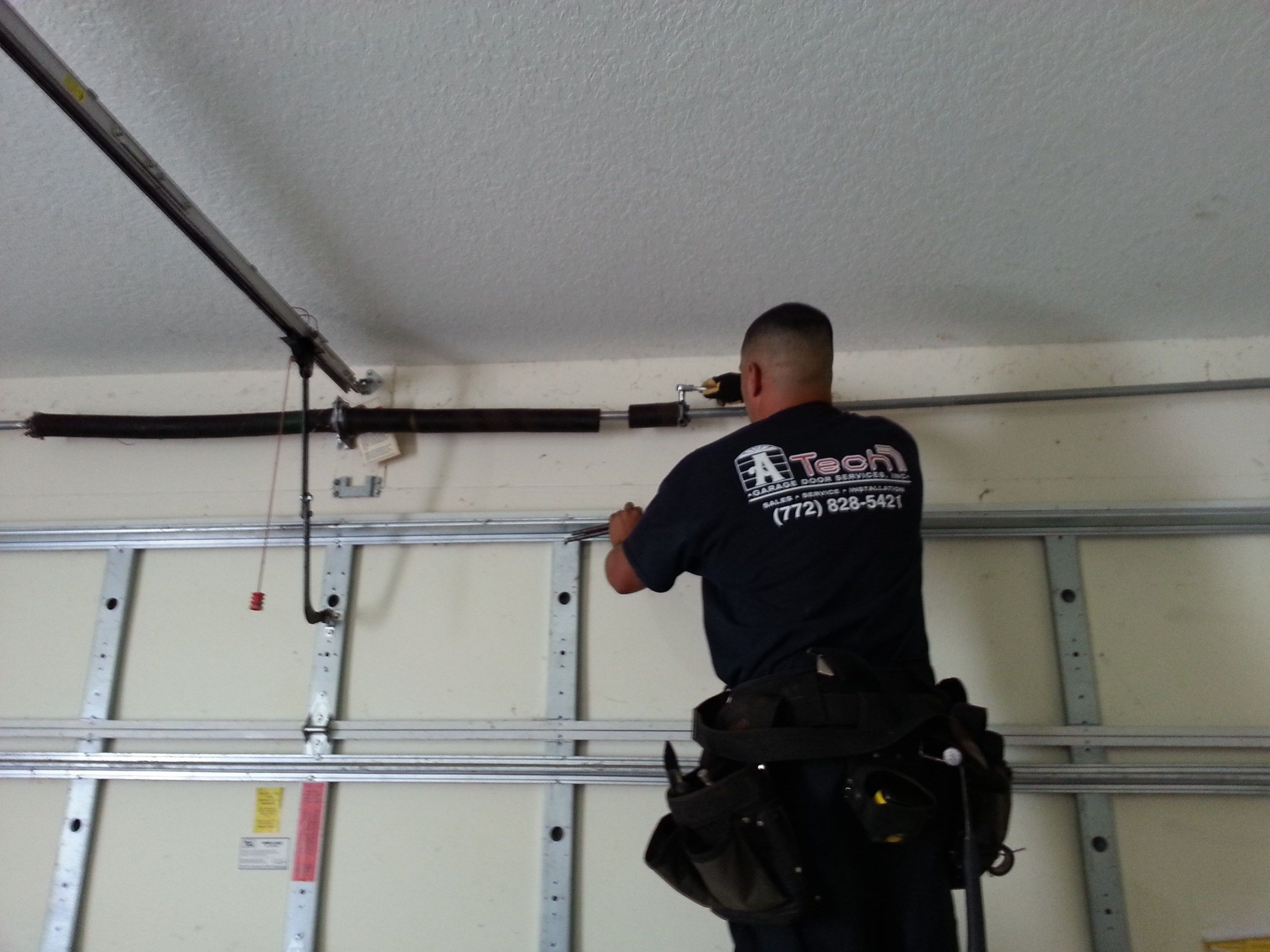 Whats The Cost To Replace Garage Door Torsion Springs Inside For How To Fix Garage Door Spring Broken How To Fix Broken Garage Door Spring