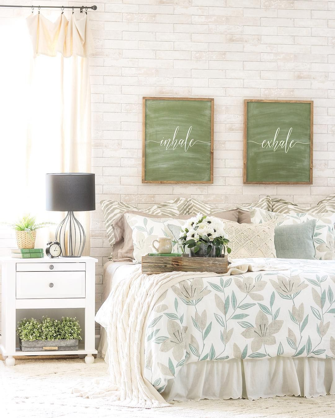 The colors of this sweet green, white, and cream bedroom