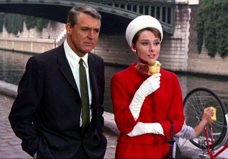 Audrey Hepburn and Cary Grant along the Seine River while shooting Charade
