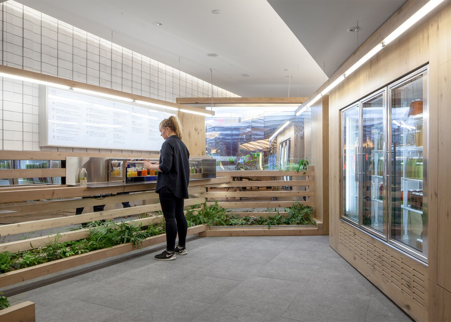 The interior of this Toronto juice bar is lined with a prefabricated ...