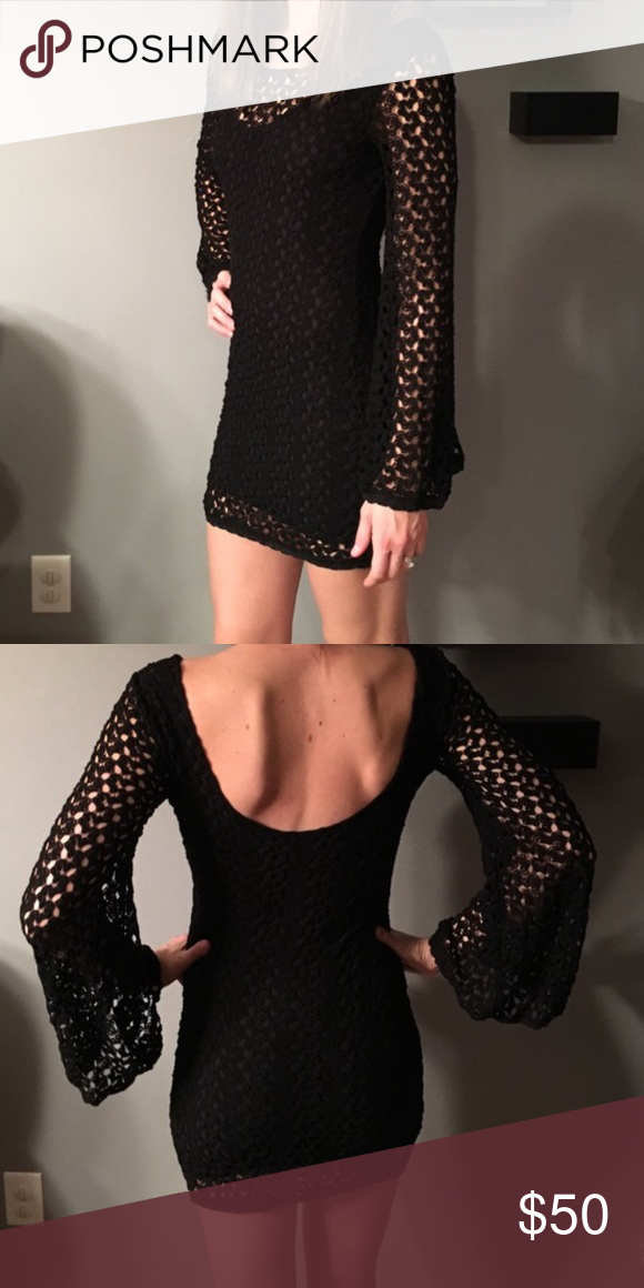 🌙🔮Free People black crochet dress this black crochet FP dress is perfect for Fall and even Halloween. I would wear this as a sexy witch out but its too small for me. model is 5'8 Free People Dresses Mini