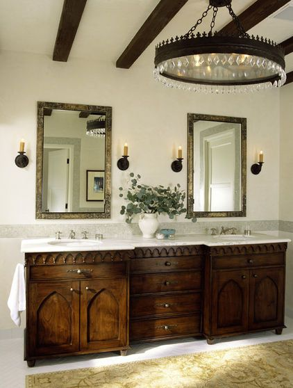 Photo of This bathroom has gothic arches in the cabinetry, but it also has those castle-w…